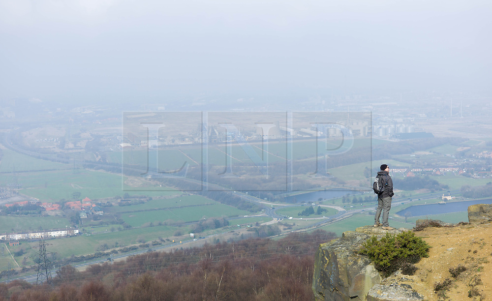 © Licensed to London News Pictures. 29/03/2014<br /> <br /> Eston Hills, Teesside, United Kingdom<br /> <br /> A man who is part of a community group called the Friends of Eston Hills looks out over Teesside from Eston Nab. The group gathered today on the top of the Nab to celebrate raising £15000 in just seven weeks to buy the land and return it to public ownership.<br /> <br /> The area will now be returned to public ownership for the first time in hundreds of years and there are plans to raise more funds to create a heritage trail, clean the site up and create a memorial to 375 miners who died when there was an iron mine on the site.<br /> <br /> <br /> Photo credit : Ian Forsyth/LNP