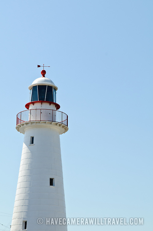 White light house on display at Sydney's Australian National Maritime Museum at Darling Harbour with a clear blue sky in the background