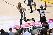 Golden State Warriors forward Andre Iguodala (9) celebrates a three pointer against the San Antonio Spurs during Game 2 of the Western Conference Quarterfinals at Oracle Arena in Oakland, Calif., on April 16, 2018. (Stan Olszewski/Special to S.F. Examiner)