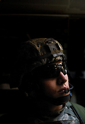 Capt. Lawson Bell rides inside the Stryker armored vehicle while he and other members of the 1st Infantry, 17th Regiment, patrol western Mosul, Iraq, Dec. 15, 2005. This is part of an effort to provide security in preparation for Iraq's first post-Saddam parliamentary elections. The western sector is home to Mosul's primarily Sunni population, which has been resistant to the American presence in Iraq.