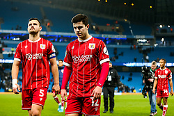 Liam Walsh of Bristol City and Bailey Wright come off the pitch after Manchester City win 2-1 in added time - Rogan/JMP - 09/01/2018 - Etihad Stadium - Manchester, England - Manchester City v Bristol City - Carabao Cup Semi Final First Leg.
