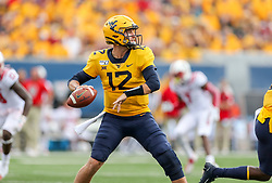 Sep 14, 2019; Morgantown, WV, USA; West Virginia Mountaineers quarterback Austin Kendall (12) throws a pass during the second quarter against the North Carolina State Wolfpack at Mountaineer Field at Milan Puskar Stadium. Mandatory Credit: Ben Queen-USA TODAY Sports