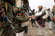 """ANA soldiers from 3rd Brigade, 201st Corps, distribute free humanitarian assistance to villagers during an operation in Tagab Valley.....Colonel Haynes said the battle plan, """"The creeping barrage of goodness,"""" to win the hearts and minds of the Tagab Valley includes: a paved road, wells, radio stations, solar power, humanitarian aid, and medical outreach.  Agricultural development teaching how to package goods, and pruning techniques to increase crop yields.  Saffron cultivation started too, as a replacement to poppy.  More projects like schools and police checkpoints will follow as resources allow..."""