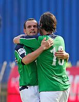 Photo: Andrew Unwin.<br />Northern Ireland v Azerbaijan. FIFA World Cup Qualifying match. 03/09/2005.<br />Northern Ireland's Stuart Elliott (L) celebrates scoring his team's first goal with his team-mate, James Quinn (R).