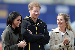 Prince Harry, Meghan Markle and Jayne Kavanagh (right), Chef De Mission for the UK Invictus team at the University of Bath Sports Training Village, Bath, for the UK team trials for the Invictus Games Sydney 2018.