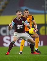 Football - 2020 / 2021 Premier League - Burnley vs Wolverhampton Wanderers - Turf Moor<br /> <br /> Conor Coady of Wolverhampton Wanderers and Ashley Barnes of Burnley at Turf Moor <br /> <br /> <br /> COLORSPORT/LYNNE CAMERON