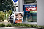 Duitsland, Germany, Deutschland, Wyler, 22-9-2013Nationale verkiezingen in de Bondsrepubliek. Poster van Angela Merkel, bondskanselier van de CDU hangt aan lantaarnpaal vlakbij de grens met Nederland. Economie en financien zijn een belangrijk thema.Foto: Flip Franssen/Hollandse Hoogte