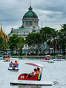 17 AUGUST 2018 - BANGKOK, THAILAND:   Paddle boats on the lake in Dusit Zoo in Bangkok, Ananta Samakhom Throne Hall, the royal reception hall for Dusit Palace, is in the background. The zoo opened in 1938. The zoo grounds were originally the Dusit Royal Garden. The zoo is scheduled to close by the end of August 2018 because it is being relocated to Nakhon Pathom province, south of Bangkok.      PHOTO BY JACK KURTZ