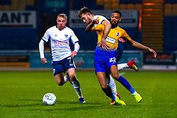 CJ Hamilton of Mansfield Town is pulls down by Will Aimson of Bury - Mandatory by-line: Ryan Crockett/JMP - 04/12/2018 - FOOTBALL - One Call Stadium - Mansfield, England - Mansfield Town v Bury - Checkatrade Trophy