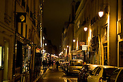 Parisians stroll down Rue Jacob in Paris, France