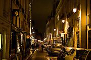 Parisians stroll down Rue Jacob in Paris, France