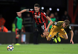 AFC Bournemouth's Adam Smith (left) and Brighton & Hove Albion's Solly March battle for the ball during the Premier League match at the Vitality Stadium, Bournemouth.