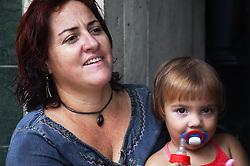 Woman and daughter in Havana doorway,
