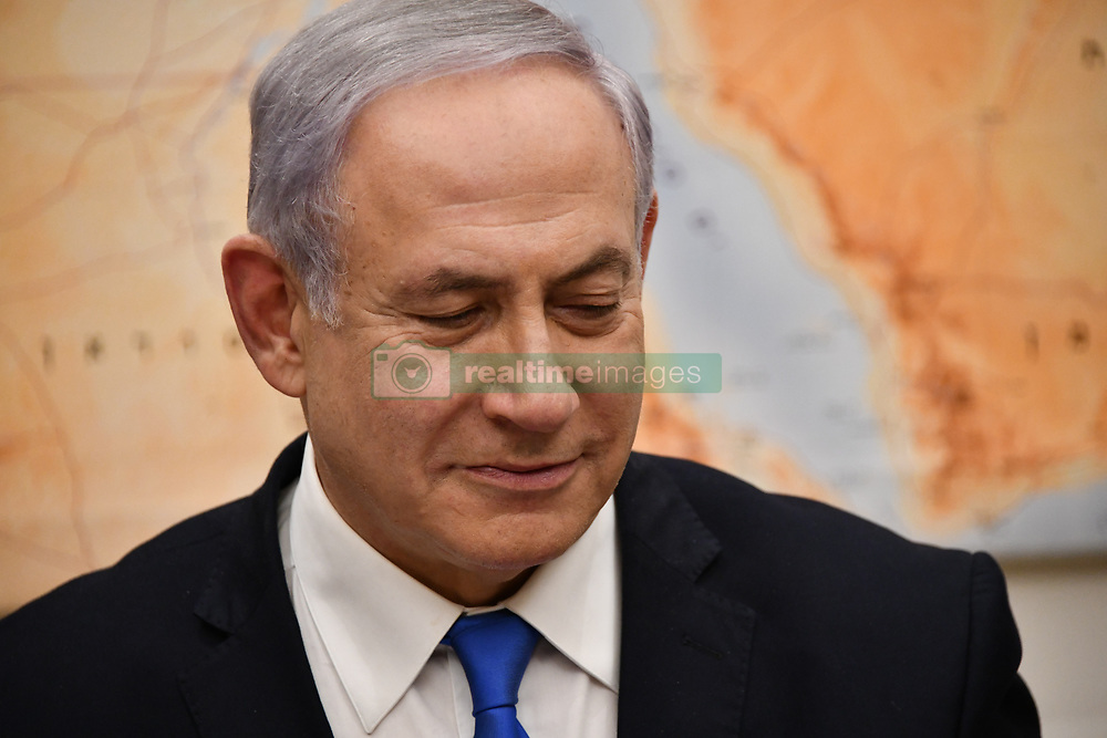March 21, 2019 - Jerusalem, Israel - Israeli Prime Minister Benjamin Netanyahu smiles after speaking by phone with U.S. President Donald Trump from his office March 21, 2019 in Jerusalem, Israel. Trump surprised Netanyahu telling him the U.S. will recognize Israeli sovereignty over the occupied Golan Heights, which it captured from Syria in 1967. (Credit Image: © Ron Przysucha via ZUMA Wire)
