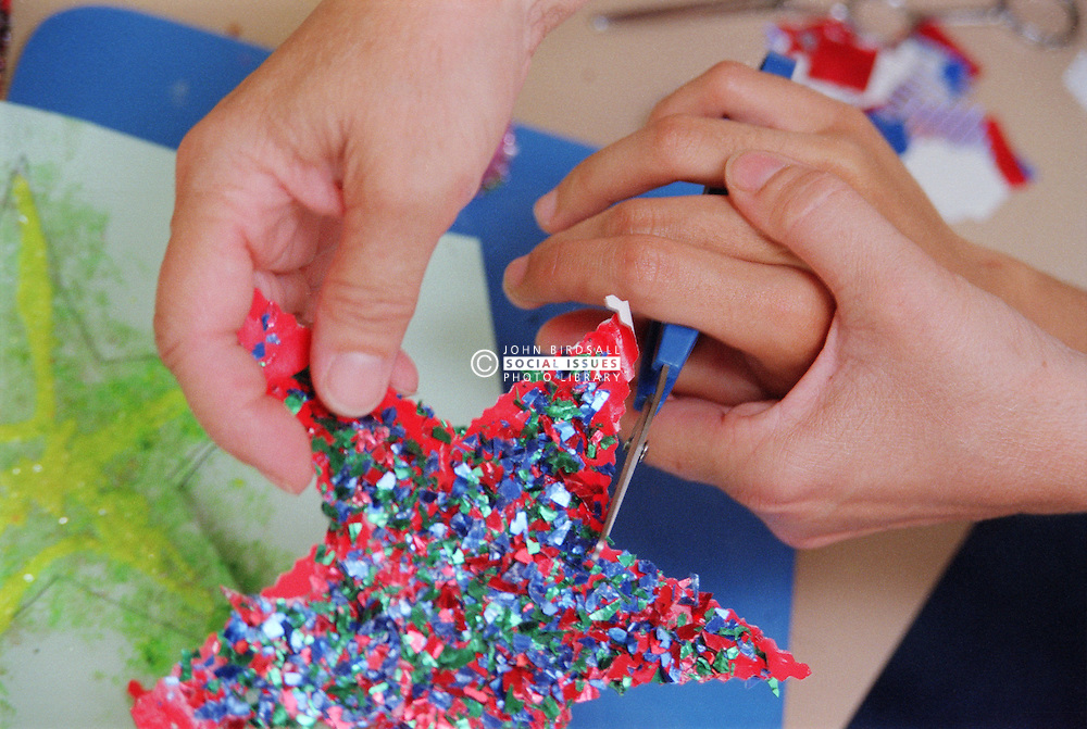 Close up of carer and patient's hands using self opening scissors,