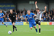 AFC Wimbledon midfielder Dean Parrett (18) dribbling and riding a challange from Rochdale midfielder Ollie (Oliver) Rathbone (14) during the EFL Sky Bet League 1 match between AFC Wimbledon and Rochdale at the Cherry Red Records Stadium, Kingston, England on 30 September 2017. Photo by Matthew Redman.