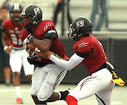 Lindenwood University - Belleville QB Anthony Dorsey (7, right) hands the ball to RB Jeremiah Clemon (5) late in the first half of their Homecoming Game against the Menlo College Oaks.