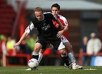 Photo: Rich Eaton.<br /> <br /> Bristol City v Swansea City. Coca Cola League 1. 07/04/2007. Thomas Butler left of Swansea holds off Bristols Lee Johnson