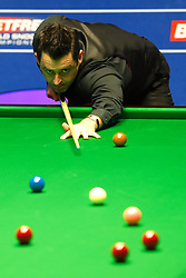 Ronnie O'Sullivan in action against against Ding Junhui, on day twelve of the Betfred Snooker World Championships at the Crucible Theatre, Sheffield.