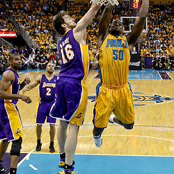 April 22, 2011; New Orleans, LA, USA; New Orleans Hornets center Emeka Okafor (50) is fouled by Los Angeles Lakers power forward Pau Gasol (16) during the first half in game three of the first round of the 2011 NBA playoffs at the New Orleans Arena. The Lakers defeated the Hornets 100-86.   Mandatory Credit: Derick E. Hingle