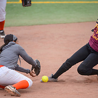 041715       Cable Hoover<br /> <br /> Tohatchi Cougar Delicia Begay (3) slides into second as the ball bounces past Wingate Bear shortstop Marion Thompson (4) Friday at Ford Canyon Park.