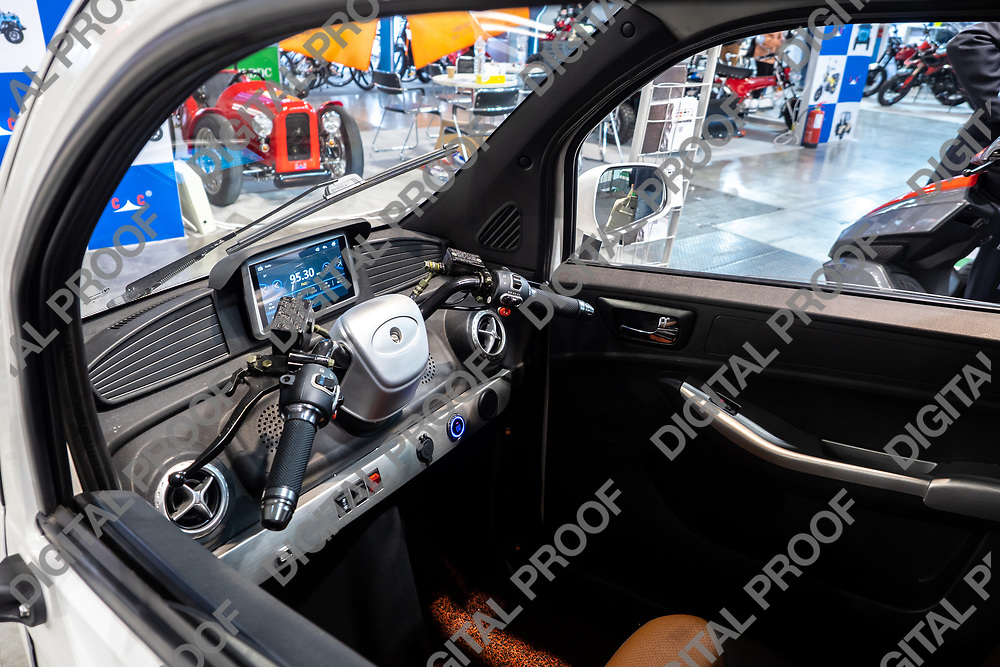 RHO Fieramilano, Milan Italy - November 07, 2019 EICMA Expo. Interior of Cab Easy Electric tricycle vehicle from UGBEST Chinese company in exhibition