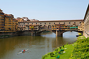 The Ponte Vecchio with it's enclosed shops, a bridge over the Arno river, Florence, Italy