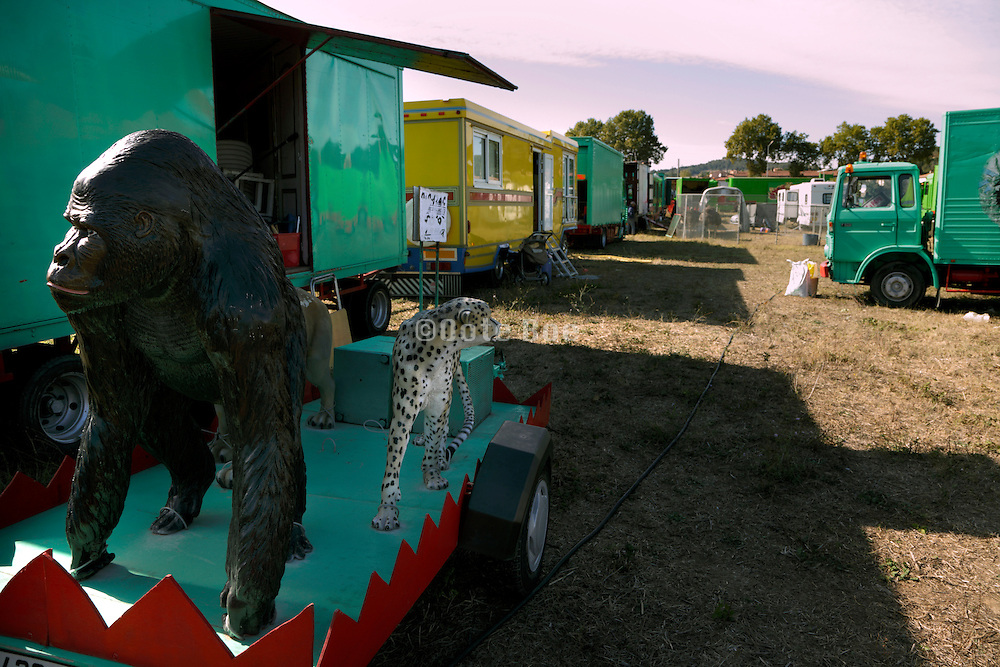 circus grounds with a parade trailer