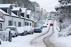 Leadhills, Scotland, UK. 27 December 2020. Heavy snow falls on Scotland's second highest village of Leadhills in South Lanarkshire.  Iain Masterton/Alamy Live News