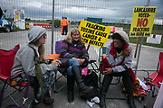 Anti-fracking  activists and protesters outside the gates of Quadrillas fracking site June 31st, Lancashire, United Kingdom. The struggle against fracking in Lancashire has been going on for years. The fracking company Quadrilla is finally ready to bring in a drill tower to start drilling and anti-frackinhg activists are waiting in front of the gates to block the equipment getting in.  Fracking is a destructive and potential dangerous and highly contentious method of extracting gas and this site will be the first of many in the United Kingdom reaching miles out under ground.