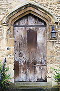 Wooden door of a house in Burford in the Cotswolds, Oxfordshire, UK