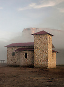 A small chapel stands alone in the landscape, close to Mount Roraima in the Gran Sabana of Venezuela