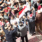 Protest leaders rally the crowd in Cairo's Tahrir Square during the Day of Justice and Cleansing.