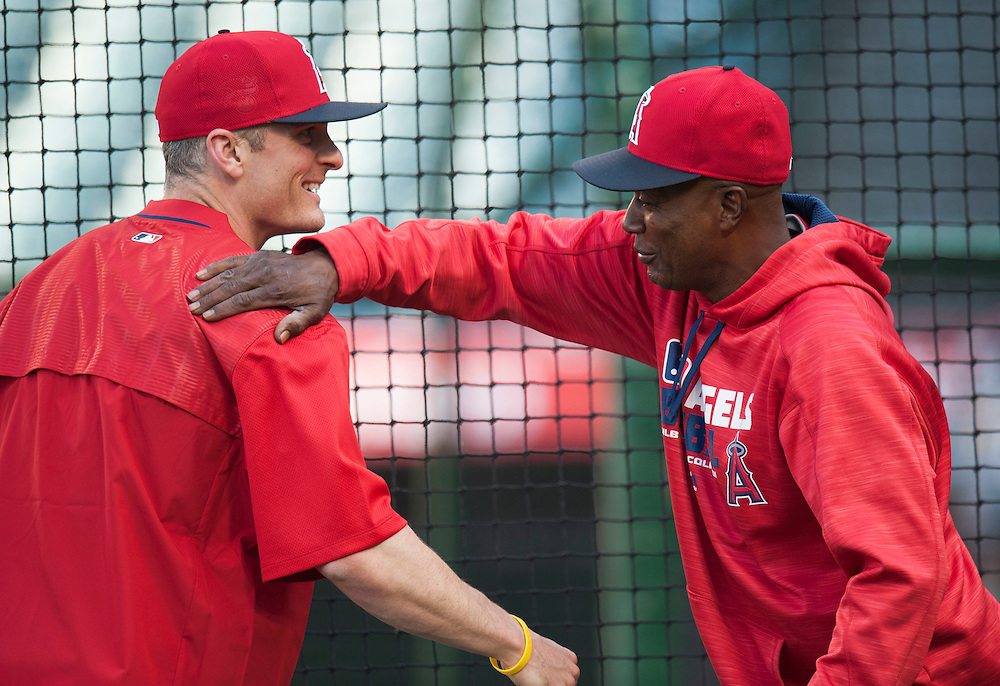 Brendan Ryan says hello to Alfredo Girffin on his first day as an Angel before their game against the St. Louis Cardinals Tuesday at Angel Stadium.