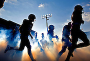 James Madison's football team take the field at the start of the final game of the season against Towson at Bridgeforth Stadium in Harrisonburg on Saturday..