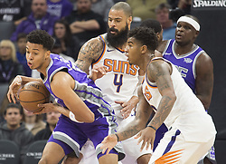 December 29, 2017 - Sacramento, CA, USA - The Sacramento Kings' Skal Labissiere (7) attempts to control the ball as he's defended by the Phoenix Suns' Tyson Chandler (4) and Marquese Chriss, right, on Friday, Dec. 29, 2017, at the Golden 1 Center in Sacramento, Calif. (Credit Image: © Hector Amezcua/TNS via ZUMA Wire)
