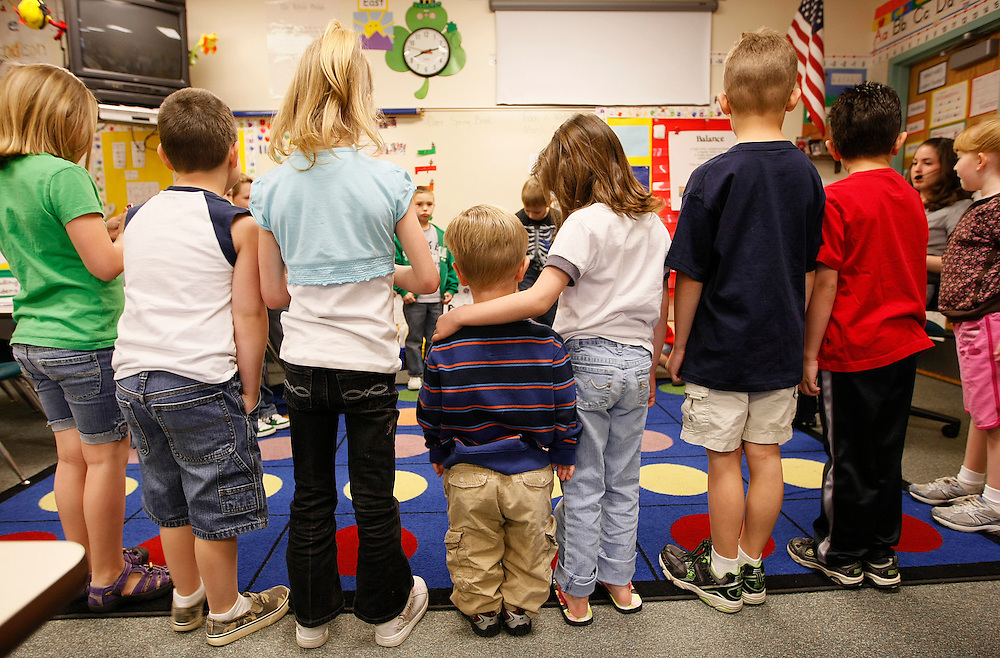 First grader Adam Kotzian (C) does a spelling drill with classmates in his classroom at Eagleview Elementary school in Thornton, Colorado March 31, 2010.  Adam and his parents are achondroplasia dwarfs but his sister Avery is not.   REUTERS/Rick Wilking (UNITED STATES)