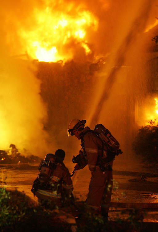 McAllen, TX - 28 Nov 2007 -.McAllen firefighters work to control a 2-alarm fire at the empty La Mexicana restaurant at 4711 N. 10th St. in McAllen on Wednesday night.  .Photo by Alex Jones / ajones@themonitor.com.