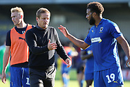 AFC Wimbledon manager Neal Ardley about to shake hands with AFC Wimbledon midfielder Tom Soares (19) during the EFL Sky Bet League 1 match between AFC Wimbledon and Oxford United at the Cherry Red Records Stadium, Kingston, England on 29 September 2018.