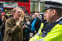 London, May 1st 2015. Anarchists and activists from Class War, a group that highlights, through direct action, the housing crisis and other economic imbalances use May Day in the City to protest on the streets, briefly blocking a number of streets and Tower Bridge as they marched behind mobile sound systems under the watchful eye of the City Police.