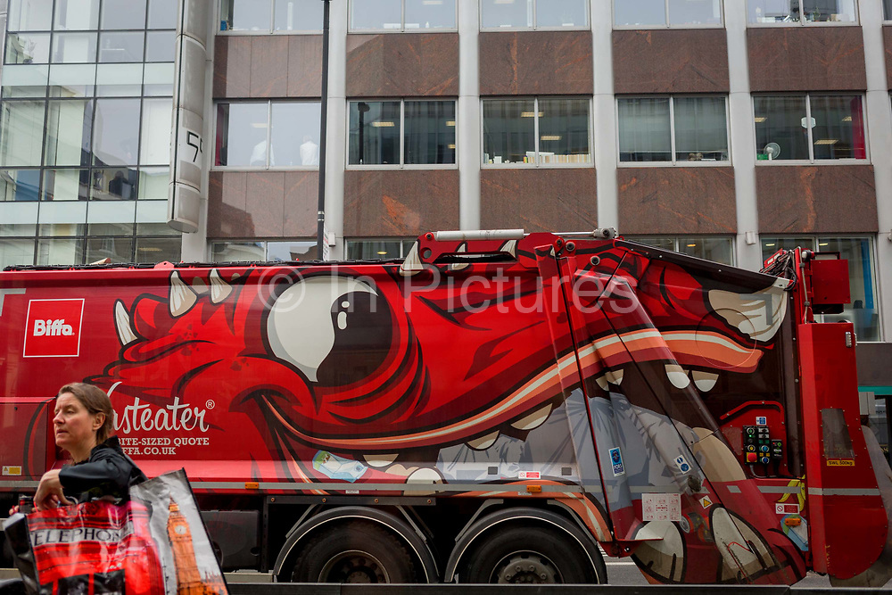 A large eye on the side of a refuse lorry passes the offices of Cambridge Analytica on New Oxford Street, the UK company accused of harvesting the personal details of Facebook users in its data privacy scandal, on 11th April, 2018, in London, England.
