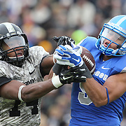 Air Force wide receiver Jale Robinette, (right), and corner back Chris Carnegie challenge for the ball which resulted in an incompletion during the Army Black Knights Vs Air Force Falcons, College Football match at Michie Stadium, West Point. New York. Air Force won the game 23-6. West Point, New York, USA. 1st November 2014. Photo Tim Clayton