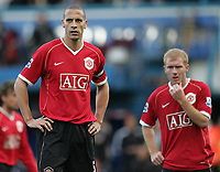 Photo: Lee Earle.<br /> Portsmouth v Manchester United. The Barclays Premiership. 07/04/2007.United's Rio Ferdinand (L) and Paul Scholes look dejected as they trail to Portsmouth.