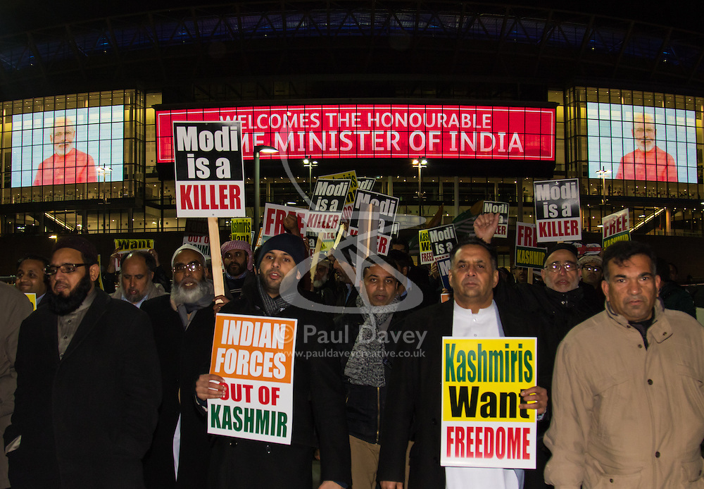 Amid high security measures, hundreds of Kashmiri protesters, supported by George Galloway, demonstrate outside Wembley Stadium ahead of an address to more than 60,000 Indian expats by Prime Minister Narendra Modi at a 'UK Welcomes Modi' reception. Modi, a Hindu and his BJP party are accused of a wide range of human rights abuses against religious and ethnic minorities in India.