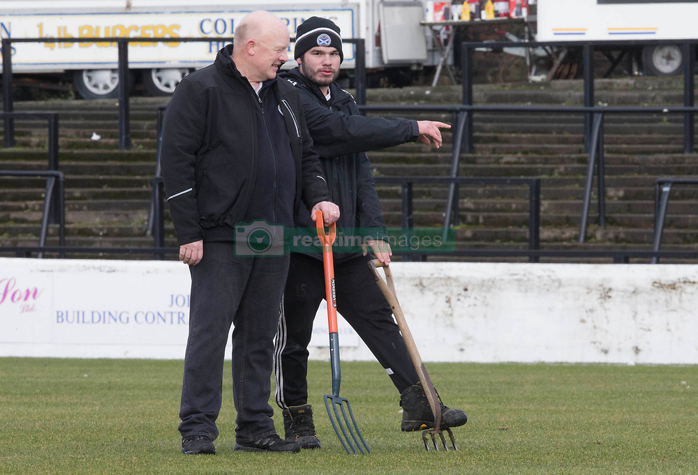 Ground staff prepare the pitch before the William Hill Scottish Cup, fifth round match at Somerset Park, Ayr.