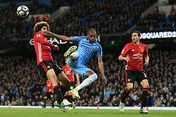 27th April 2017 - Premier League - Manchester City v Manchester United - Fernandinho of Man City battles with Marouane Fellaini of Man Utd - Photo: Simon Stacpoole / Offside.
