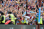 Jack Grealish of Aston Villa jumps into the Villa fans as he celebrates after he  scores his teams 3rd goal . EFL Skybet championship match, Aston Villa v Rotherham Utd at Villa Park in Birmingham, The Midlands on Saturday 13th August 2016.<br /> pic by Andrew Orchard, Andrew Orchard sports photography.