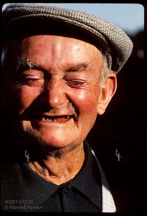 Portrait of laughing man with missing teeth; town of Crac'h, Morbihan, Brittany. France