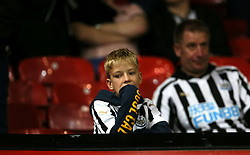 A young Newcastle United fan in the stands during the match