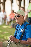 John Mullally listens as John Hall speaks to the crowd during the 70th Anniversary celebration of the Kiwanis Pool in St. Johnsbury Vermont.  Karen Bobotas / for Kiwanis International